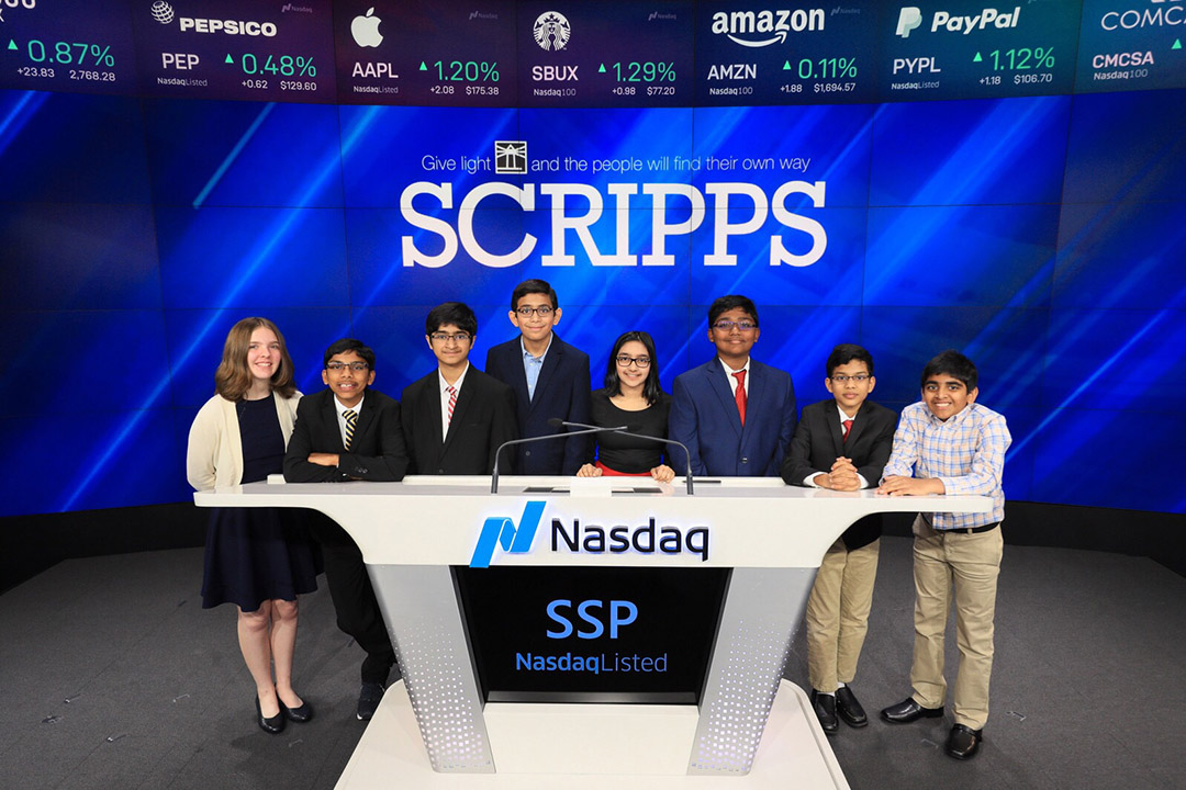 Scripps National Champions Posing Behind the NASDAQ Desk after ringing the morning bell