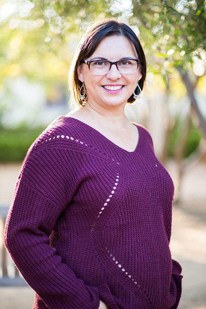 Ann Marie Batista wearing a purple sweater