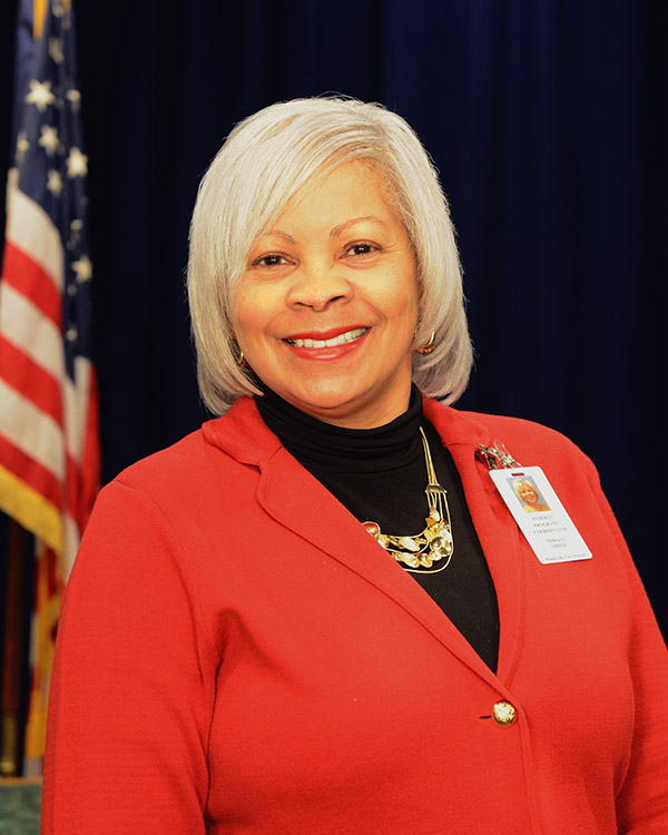 Ms. Towana Smith head/shoulders in front of American Flag
