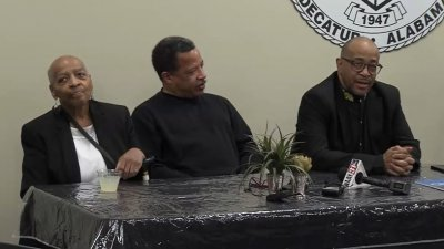 Huntsville Civil Rights figures seated at a table during the reunion event