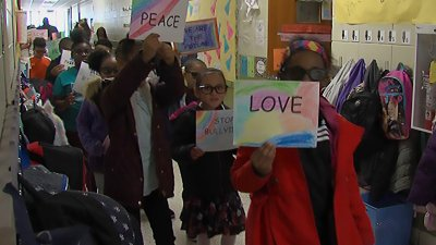 Students at Dawson Elementary marching in honor of Dr. Martin Luther King Jr.