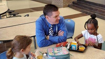 Dr Bradley Scott speaking to kindergarten students in the cafeteria