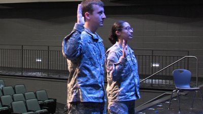 JROTC Cadets Brian Kent and Alandra Herrera being sworn in via a remote to the International Space Station