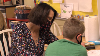 Mrs Susan McCluskey working with a student in her classroom