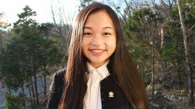 Sarah Tran wearing a black jacket outsidee