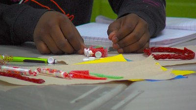 Student doing an activity with sour gummy and other candy