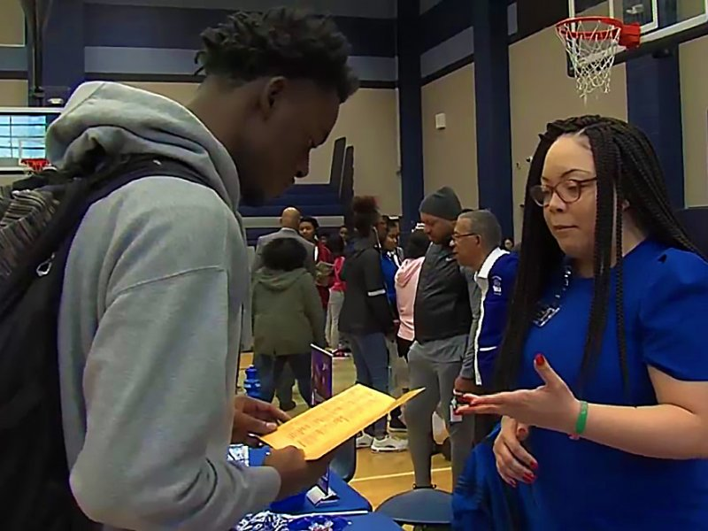 Lee High student conversing with a college adviser at the HBCU fair