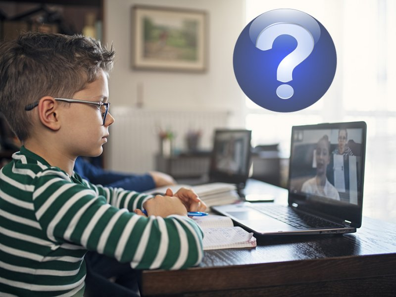 Student working on a laptop with a virtual classroom.  Blue question mark icon hovering over the computer.