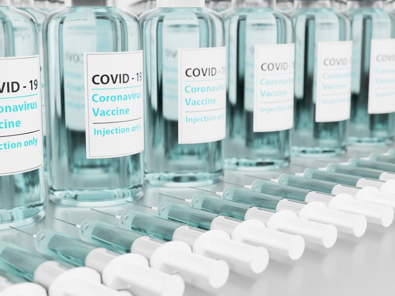 Bottles of the Covid-19 Vaccine and syringes