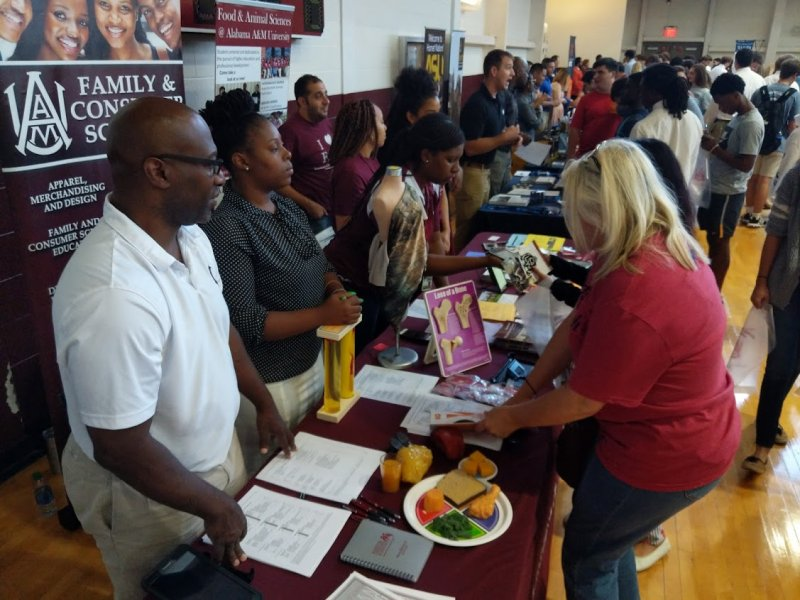 Students and parents speaking to Alabama A&M Rep at 2019 College & Career Expo