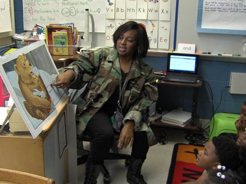 Ms. Dorris Danner teaching a book to her kindergarten class at Highlands Elementary