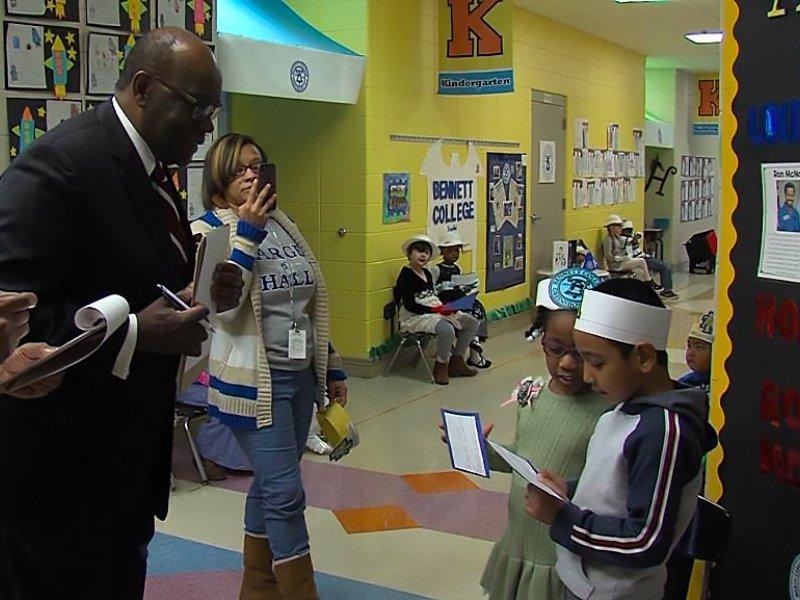 HBCU Door Decoration Judges interviewing students in the hallway