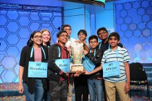 "2019 Scripps National Spelling Bee ""Octochamps"" holding their trophy together"
