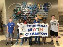 Academy for Academics and Arts Math Competition Winners from 5th Grade holding a Perennial Math Champion sign