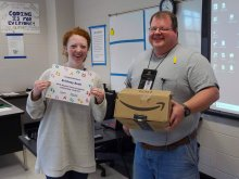 Brittney Bush holding her amazon certificate alongside Jeff Baker who is holding an Amazon box