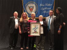 Faculty and Staff from Challenger Middle stand with Blue Ribbon personnel as the school receives award