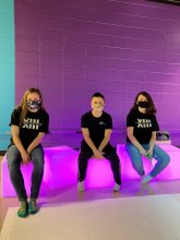 Challenger Middle Hypertext Assassins sitting on glowing purple cubes
