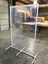 A tall desk divider fabricated by HCS
