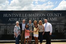 Coach Doss with his family and Erin Conroy of USA Today