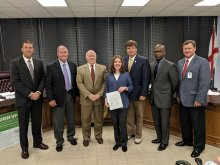 Erin Howard with the Madison County Commission Presenting her a Resolution