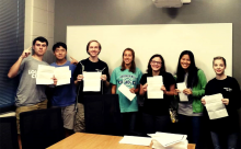 GHS National Merit Semifinalist Students holding their certificates