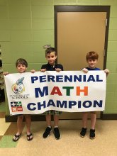 3rd Grade Champions from Goldsmith Schiffman Elementary Holding a Math Competition Sign