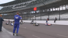 Greenpower Cars Racing on Indianapolis Speedway