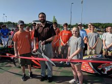 Students and Faculty cutting the ribbon at the new Grissom Greenpower Racetrack
