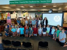 Students, Faculty, and District Administrators pose at the Blue Ribbon Award announcement ceremony in the library