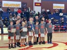 Hampton Cove 7th grade boys basketball players holding trophy