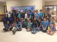 "A class at Jones Valley Elementary shows their ""blue"" participation in Autism Awareness Day"