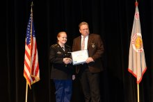 Cadet Jelynn DeCrow receiving awards from the Chief of Police