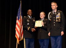 Jelynn Shaking Hands with ROTC Teacher, with another ROTC student standing beside them