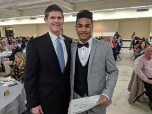 Jerwuan Thomas receiving an award from Scott Stapler for MVP at Football Banquet