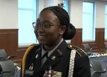 Ketty-Daphney Ngwese being interviewed while smiling and wearing her JROTC uniform