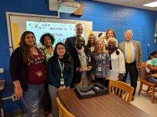 Dr. Hannon poses with HCS Administration and Teachers for the LENA Award Presentation