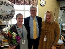 Lori Rhonemus receiving teacher of the year from Dr. Akin and Principal