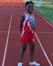 Max Patterson Posing on a track with medals around his neck