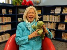 Ms. Meg Barry with a stuffed animal in remodeled library