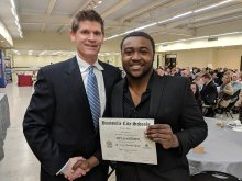 Mel Dantzler receiving award from Scott Stapler for Offensive Player of Year at Football Banquet