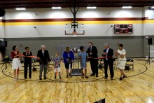 District Officials and Invited Dignitaries cutting the ribbon to open Morris P-8
