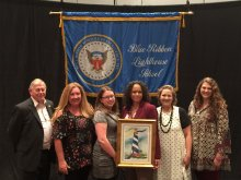 Faculty and Staff from Mt. Gap P-8 stand with Blue Ribbon personnel as Mt. Gap receives award