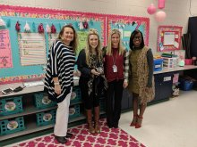 Mahgan Arnold posing with principal and other district and school staff with her National Board Certification letter