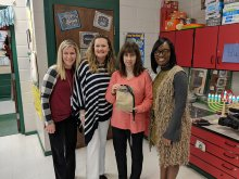 Sharon Lakin posing with principal and other district and school staff with her National Board Certification letter