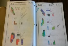 PLTW Student Notebook showing 3 dimensional objects drawn on graph paper