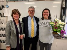Rebecca Phillips receiving teacher of the year award from Dr. Akin and principal
