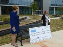 Elizabeth Fleming and Melissa Thompson speaking to media before presenting the check to local school leaders