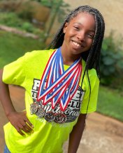 Samiah Harden posing with several track and field medals hanging from her neck