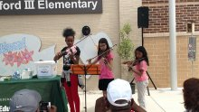 Students Play Violin at Sonnie Hereford Outdoor Classroom Ceremony