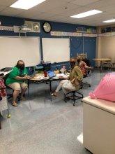 Masked teachers prepping for blended learning